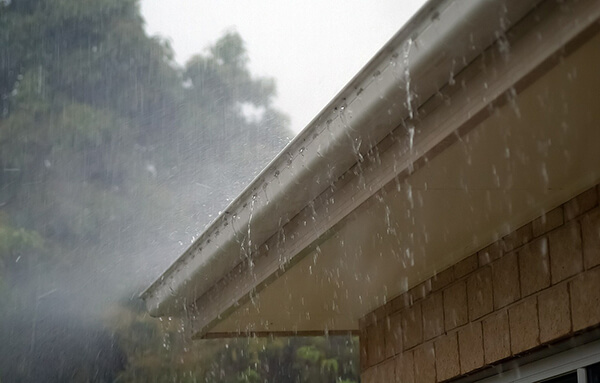 Rain water flowing from a leaked gutter