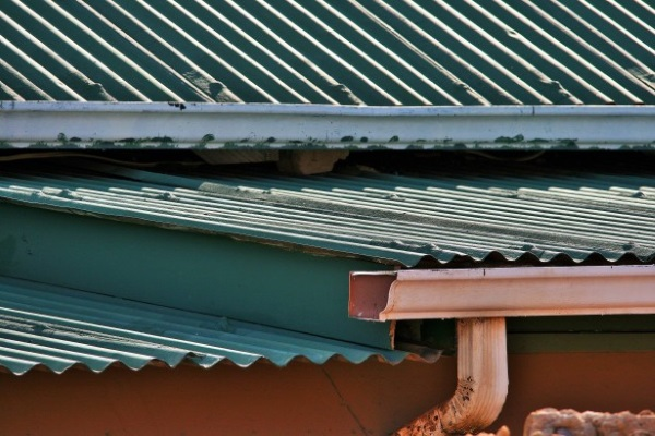 An aged corrugated metal roof and a gutter