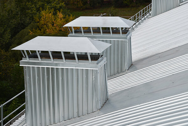 Roof vents on a metal roof