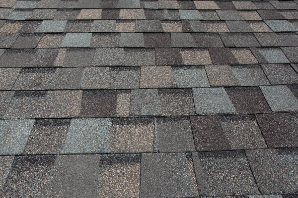 a finished installation of architectural shingle roofs